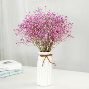 Chọn hoa trang trí phòng khách đẹp nao lòng